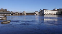 Hydro electric power station pan left to right river stream in front Stock Footage