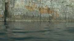 View of cliffs on the seashore seen from a boat, Krk Island - stock footage