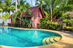 Stock Photo of Swimming pool on a tropical beach