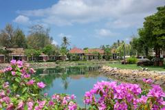 Stock Photo of Cottages on the Bay in a tropical garden
