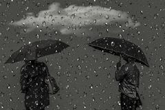 Stock Illustration of Silhouettes of men and women under umbrellas.