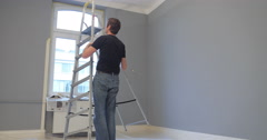 man renovating his new home - stock footage