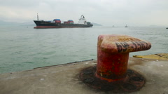 View of Mooring Bollard and in the Distance a Huge Tanker Filled Containers Stock Footage