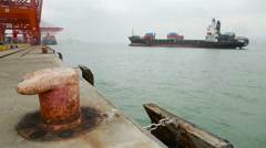 View of Mooring Bollard and a Huge Tanker Filled Containers Stock Footage