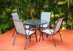 Stock Photo of Table and chairs on the veranda in a tropical garden