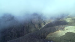 Fogs move hurriedly on high mountain valley Stock Footage