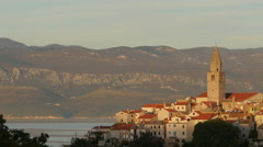 Beautiful view of a church tower and buildings in Vrbnik Town on Krk Island Stock Footage