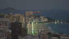 Stock Video Footage of High angle steady shot of Ipanema Beach at dusk in Rio de Janeiro