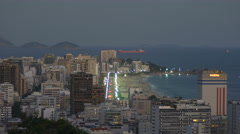 Stock Video Footage of High angle establishing shot of Ipanema Beach at dusk in Rio de Janeiro