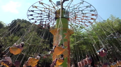Swing ride in Janfusun Fancyworld, Jian Hu Shan Theme Park, Taiwan - stock footage