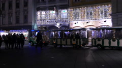 Stock Video Footage of Christmas train stopped in front on Adler Apotheke on Christmas in Graz