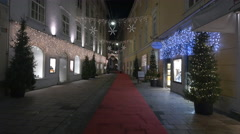Stempfergasse street with a red carpet and ornaments on Christmas in Graz Stock Footage