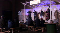 People listening a band performing at the Christmas market in Graz Stock Footage
