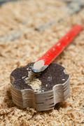 Carpenter tools lying on wood chips Stock Photos