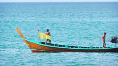 Local Fishermen Piloting their Longtail Boat off Phuket. FullHD video Stock Footage