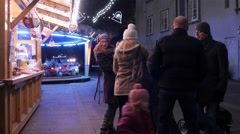 Children and parents at the Christmas market in Graz Stock Footage