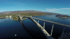 Aerial shot of cars driving on Krk Bridge on a sunny day, Krk Island Stock Footage