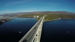 Aerial view of vehicles driving on Krk Bridge on a sunny day, Krk Island Stock Footage