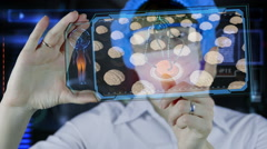 Doctor with futuristic hud screen tablet.Human brain xray. - stock footage