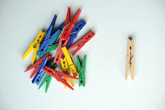wooden clothespin surrounded by color - stock photo
