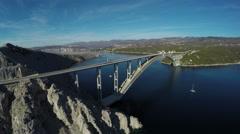 Aerial shot of Krk bridge over the Adriatic Sea and cliffs, Krk Island Stock Footage