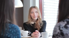Young girl sitting and talking, good for job interviews and college stuff Stock Footage