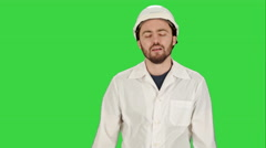 Frustrated workman in helmet over on a Green Screen, Chroma Key Stock Footage