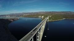 Cars driving on Krk Bridge over the sea, Krk Island, aerial shot Stock Footage