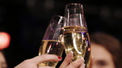 The ringing of glasses of champagne during a toast Stock Footage