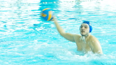 Water polo players pass ball Stock Footage