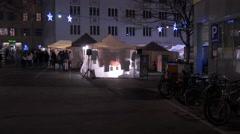 Tourists walking at the Christmas market in Tummelplatz square, Graz Stock Footage
