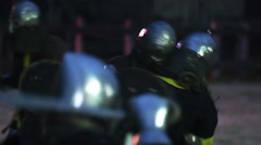 Warriors in knight armor fighting on battlefield, reenactment of medieval war Stock Footage