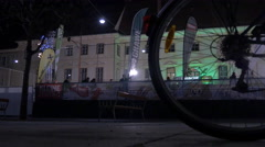 Bike parked in Karmeliterplatz square, next to the ice ring on Christmas, Graz Stock Footage