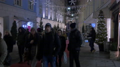 Walking by Oui store on Stempfergasse street on Christmas in Graz Stock Footage
