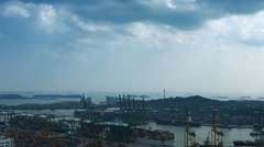 Overlooking view of Singapore's shipping port and cargo ships moored offshore - stock footage