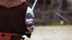 Stock Video Footage of Knight tournament between two brave rivals. Reenactment of medieval battle