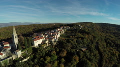 Aerial view of a church tower and buildings of Vrbnik town Krk Island Stock Footage