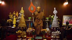 Wax sculpture of a former abbot, inside Wat Chalong temple complex in Phuket Stock Footage