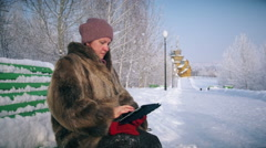 Amazed wow woman looking a tablet application in a snowy mountain on vacations Stock Footage