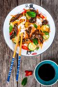 Stock Photo of Lamb noodle salad with cucumbers, carrots, chili peppers and mint