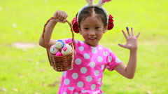 Little girl enjoy with easter egg in basket - stock footage