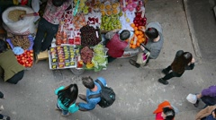 Street vendor selling assorted fruits on the sidewalk. Video 1920x1080 - stock footage