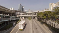 Elevated commuter train and typical highway traffic in Hong Kong. FullHD vide Stock Footage