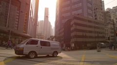Light, early morning taffic at a downtown intersection in Hong Kong Stock Footage