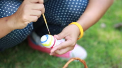 Woman painting egg preparing for easter Stock Footage