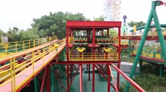 A staff person preparing the rollercoaster of Janfusun Fancyworld, Taiwan Stock Footage