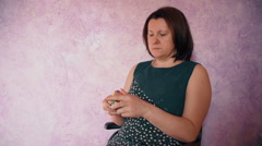 woman sitting collect the Rubik's Cube - stock footage