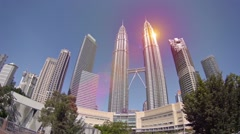 Vertical panning view on Petronas Twin Towers and buildings Stock Footage