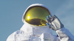 4K Astronaut on hospitable planet waves to celebrate a safe landing - stock footage