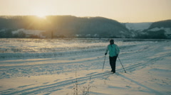 Teenager learning how to ski in the blue sky ant mountains background - stock footage
